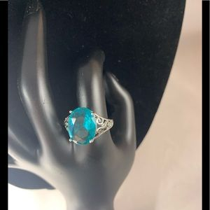 Sterling silver ring with colored aqua stone.
